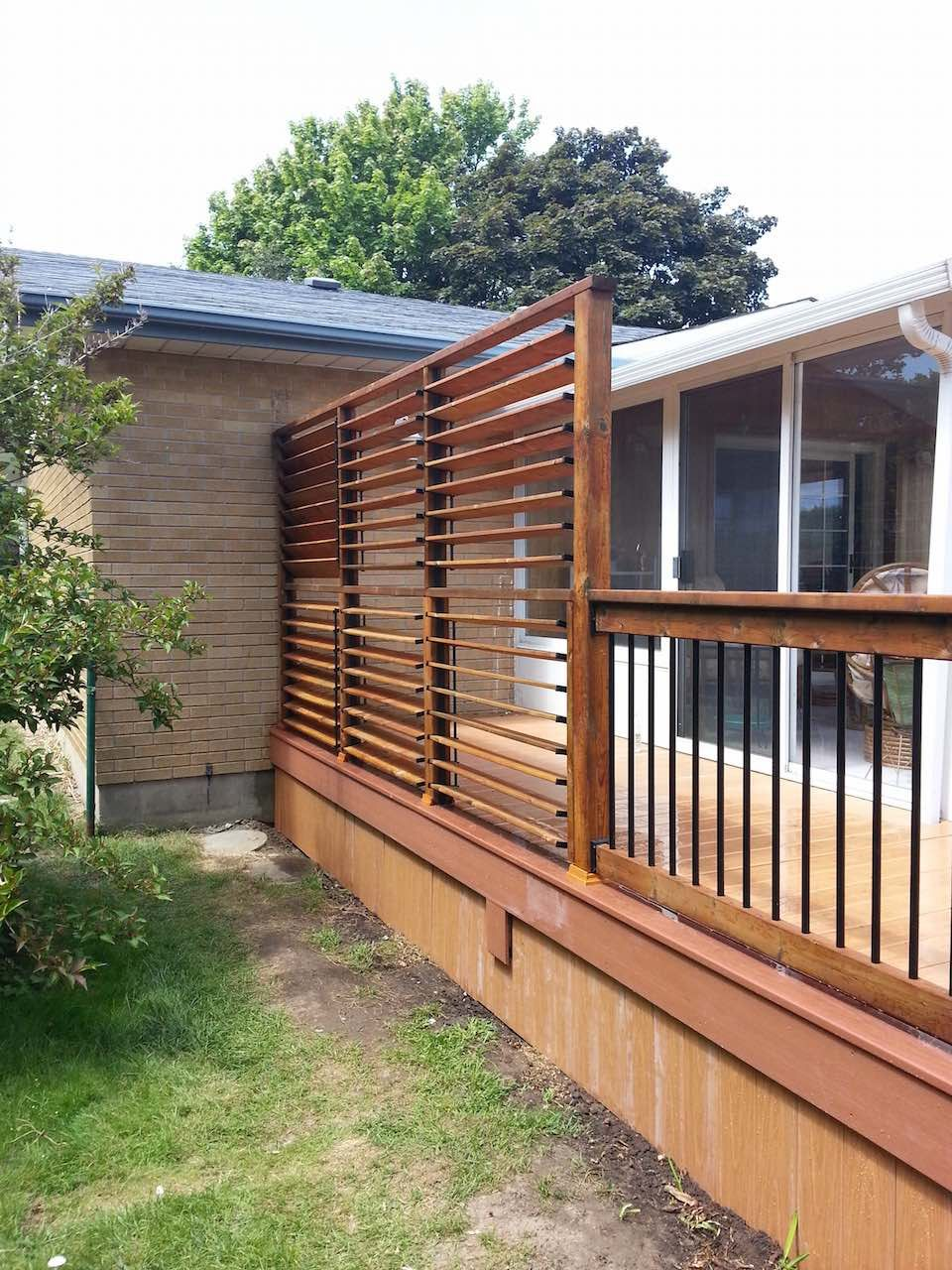 Backyard privacy screen louvers great solution by flex for Wood patio privacy screens
