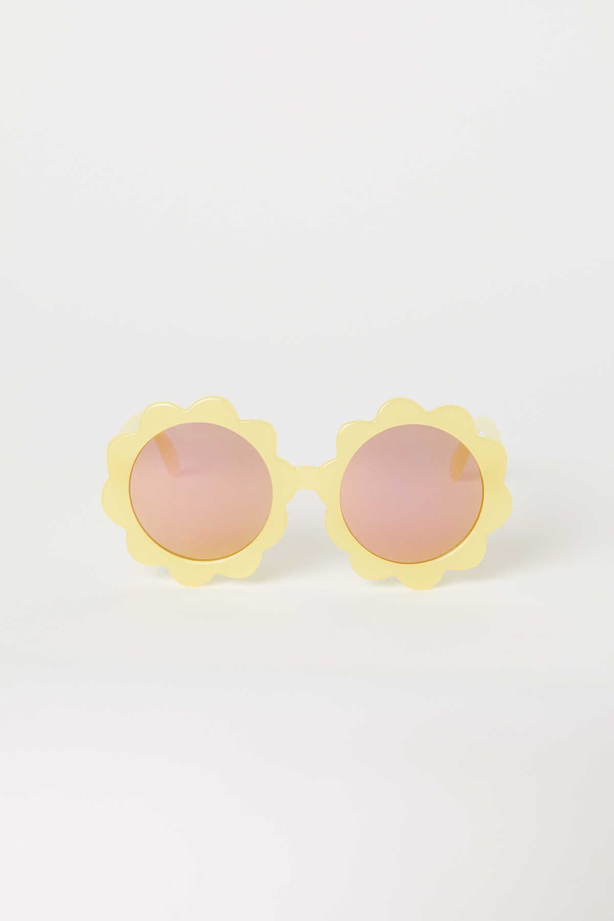e2d03344b1 Yellow flower. Sunglasses with plastic frames and UV-protective ...