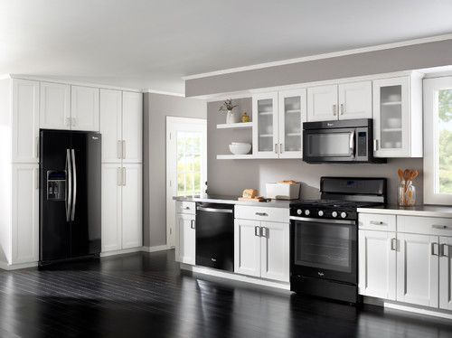 Black appliances white light grey cabinets and darker White cabinets grey walls