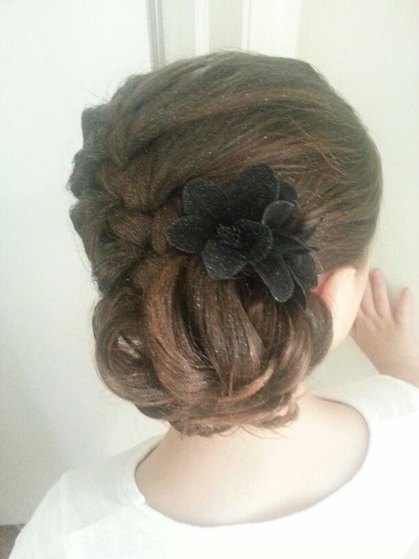 Young/flower girl updo with spray glitter.