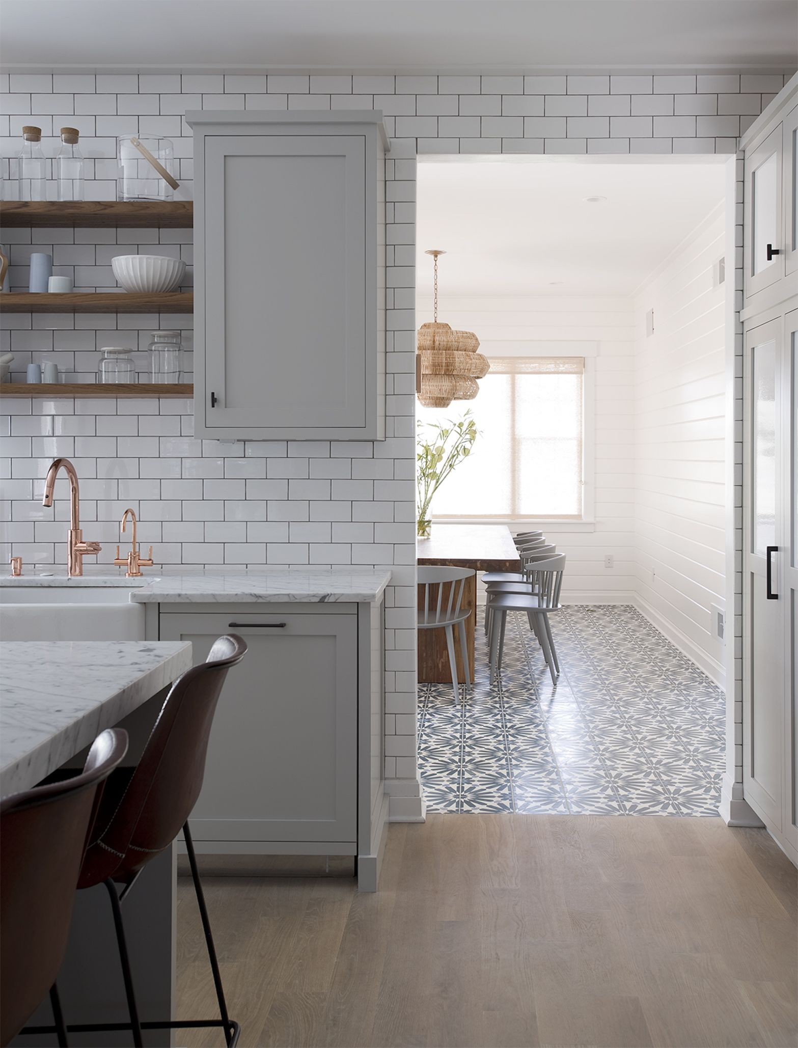 White Subway Tile Walls And Patterened Floors Threshold