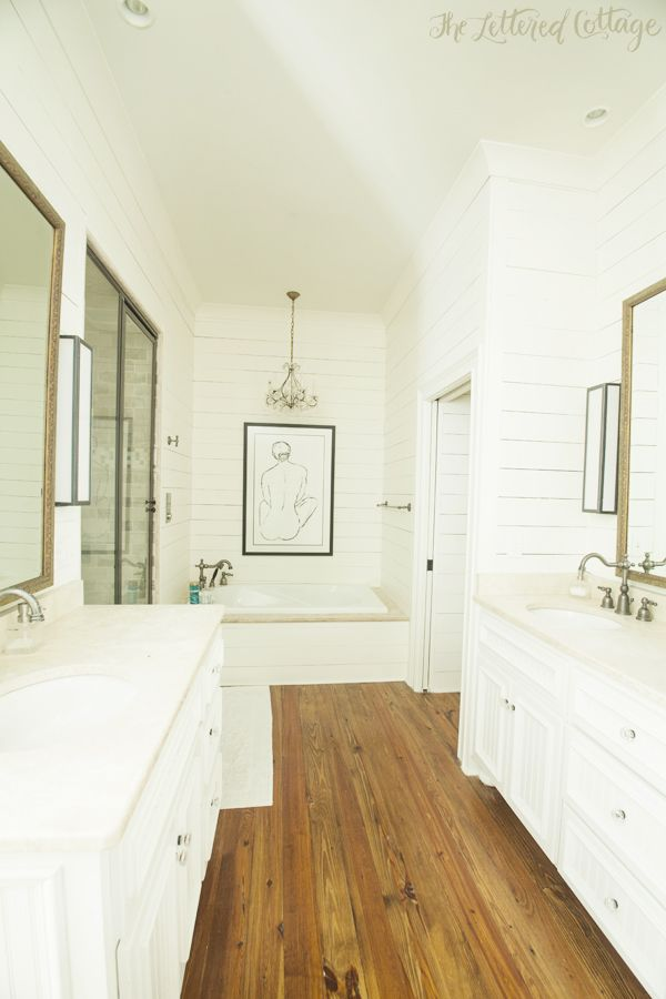 Traditional bathroom white and wood wood floors for for Hardwood floor in bathroom