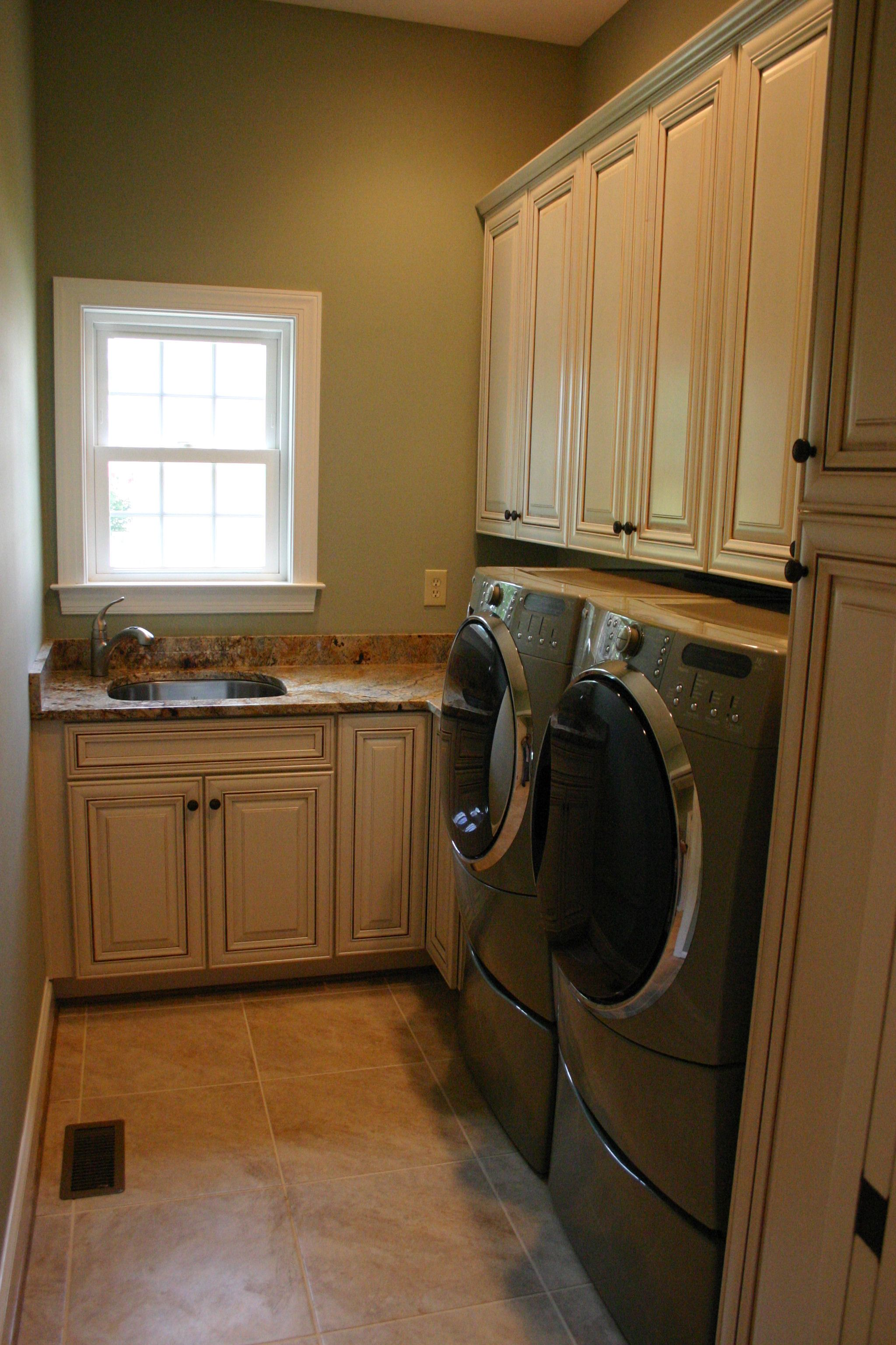 Custom Laundry Room With Cabinetry Build In Linen Storage Closet