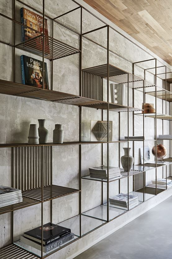 Cement screed wall- metal and glass shelves