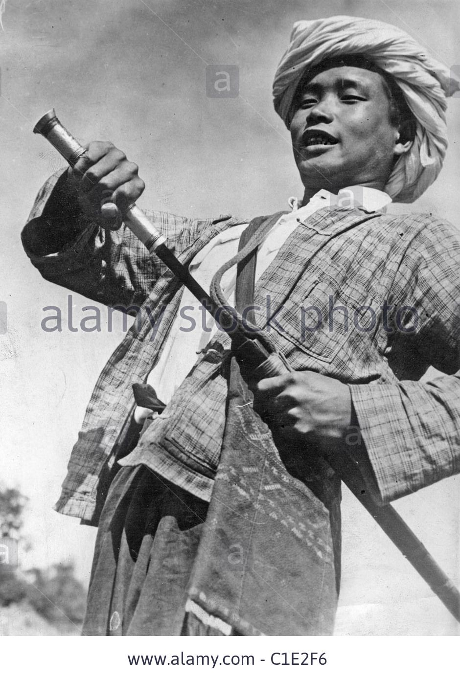 BURMA 1940 Member of the Kachin tribe fighting the Japanese invasion. His  sword is called a Dah. Stock Photo