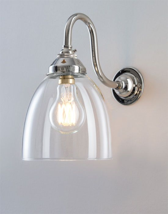 Old School Electric glass swan arm wall light is part of Glass wall lights - This wall light combines the elegance of a swan arm with the classic beauty of our blown glass shades  This light is available with either a standard or bathroom IP rated fitting  please select accordingly  The IP wall light is shown with a polished brass fitting  but it is also available in all the other finishes