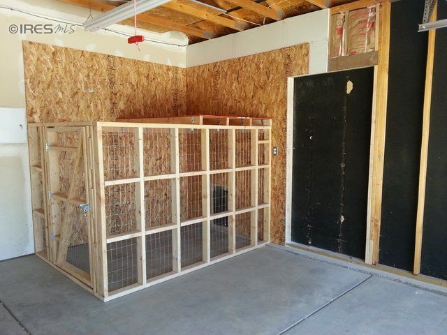 doggy run inside garage with dog door to go inside or