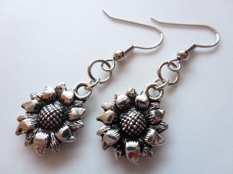 Sunflower earrings:   https://www.etsy.com/listing/110329039/silver-sunflower-earrings