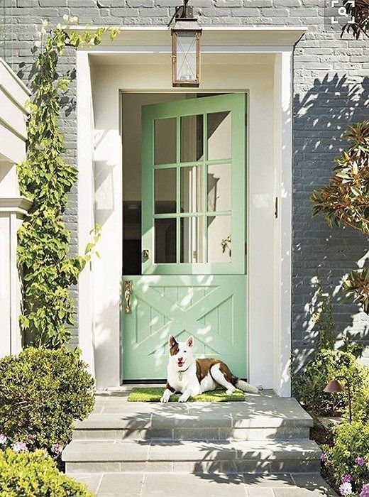 Love this beautiful mint green painted Dutch door against the bright white window trim and painted gray brick home exterior.