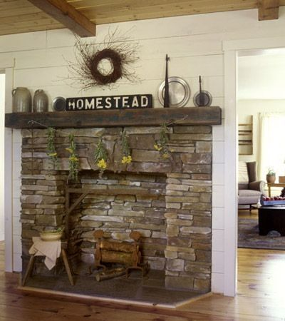 Instead of a tall piece of artwork, crown a horizontal wood sign with a wreath hung on the wall.
