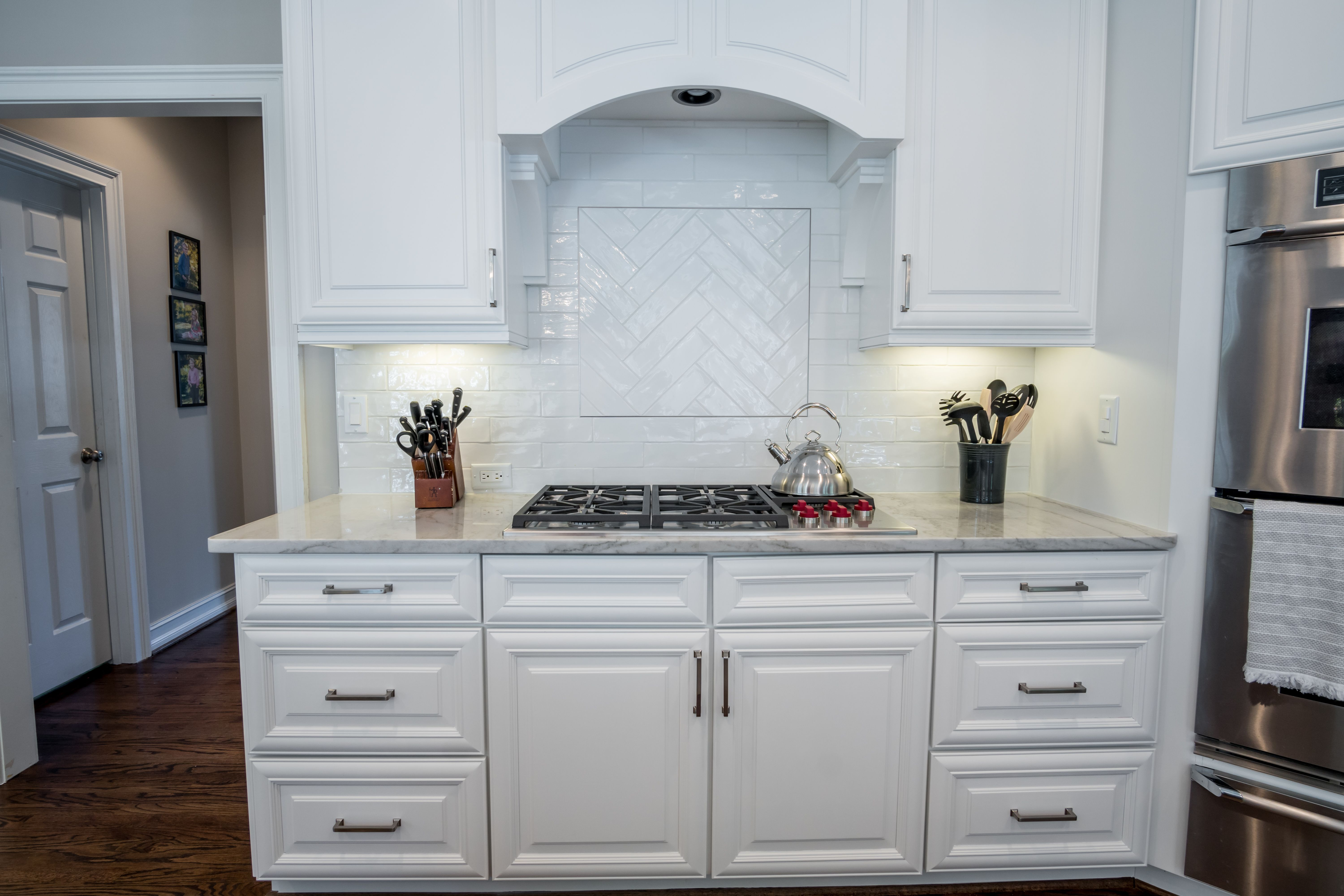 Herringbone Tile Schluter Strip And White Cabinets Cooktop Hood Corbels Kitchen Design Kitchen Stove Herringbone Tile