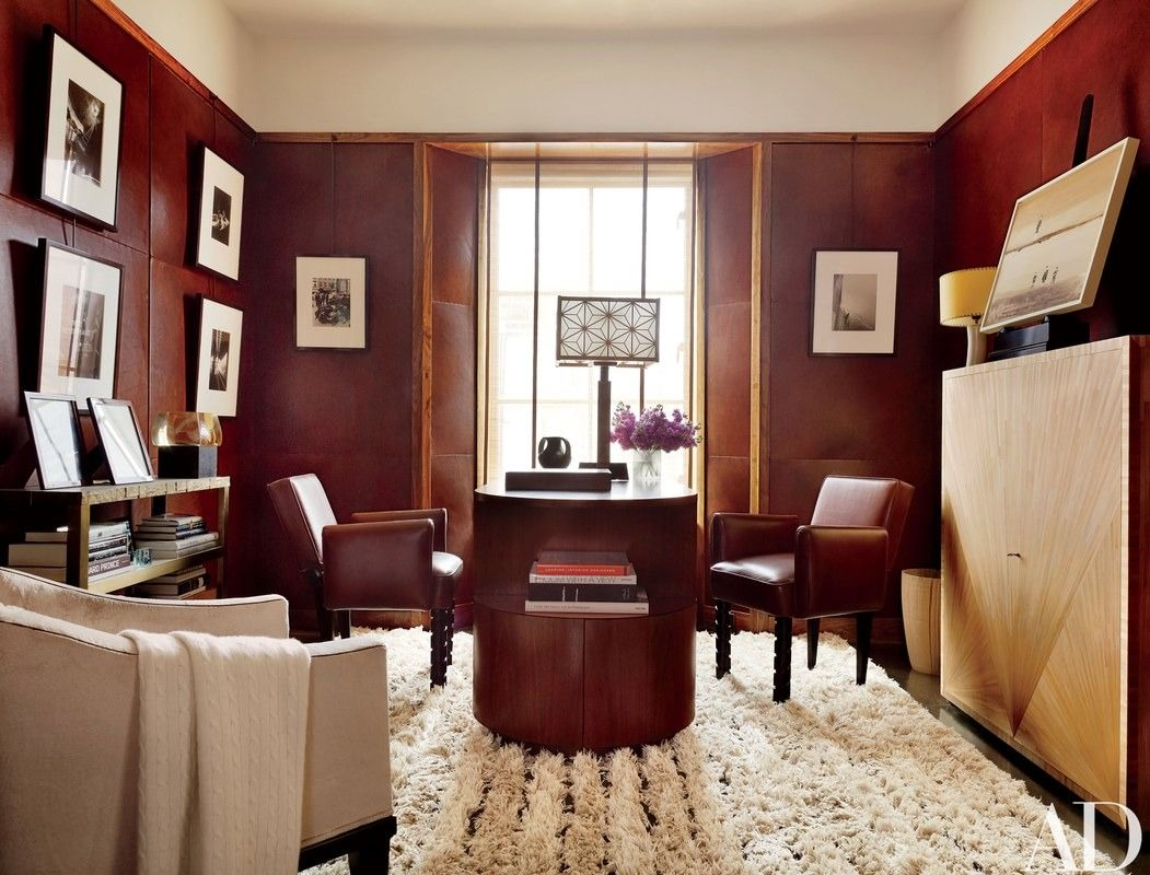 The study is appointed with a desk and straw-marquetry cabinet, both by De la Torre, a lamp (at center) commissioned from Mira Nakashima, and vintage André Sornay chairs covered in a Rose Tarlow Melrose House leather | archdigest.com