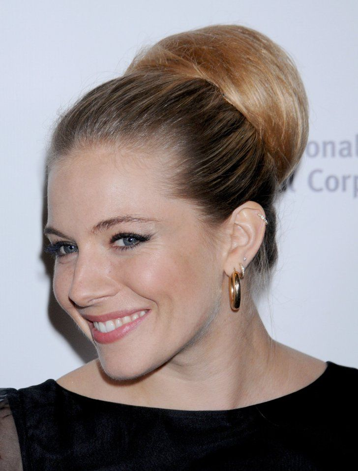 Pin for Later: Sienna Miller Is More of a Hairstyle Chameleon Than You Realise Retro Bun in 2011