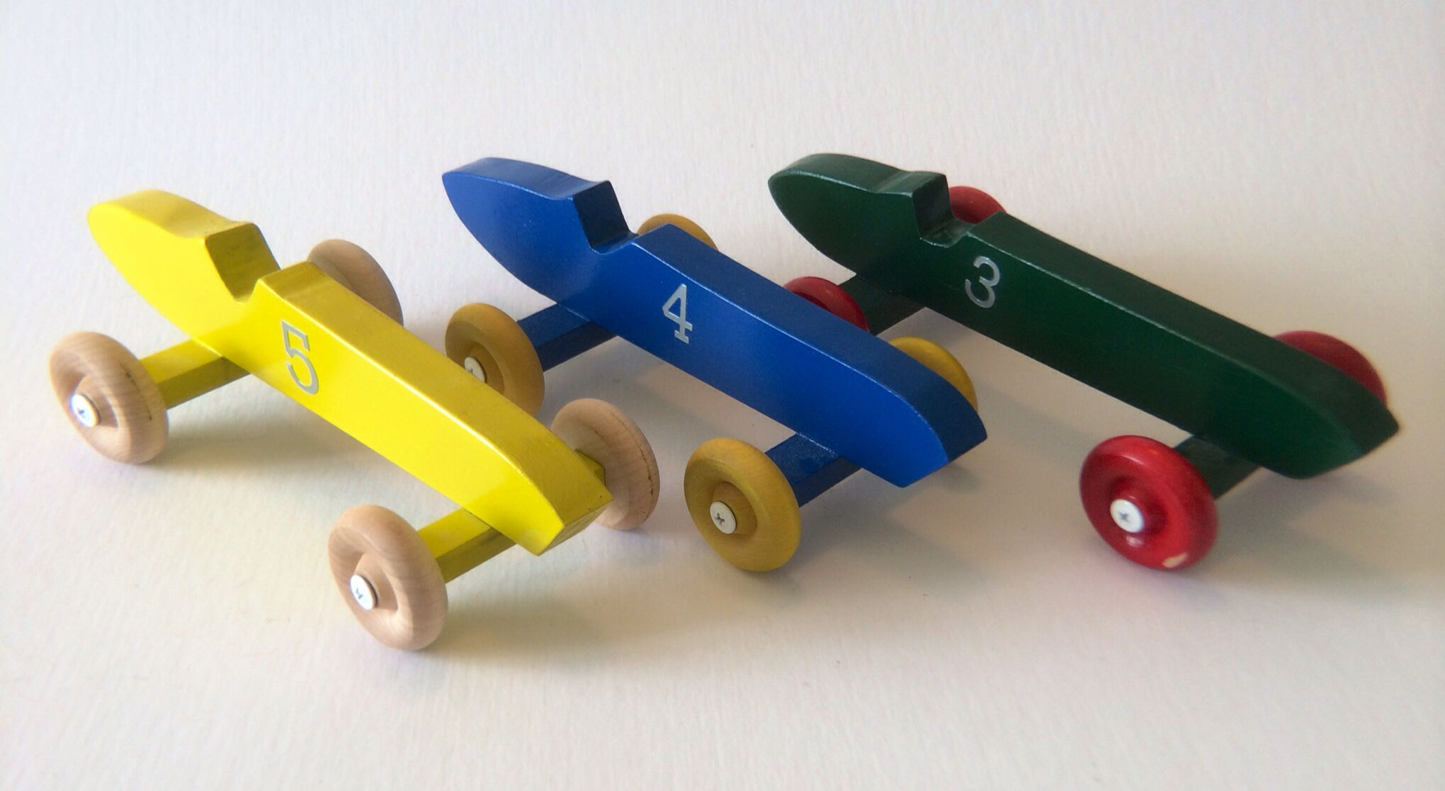 Racing cars in a variety of colours and in two sizes