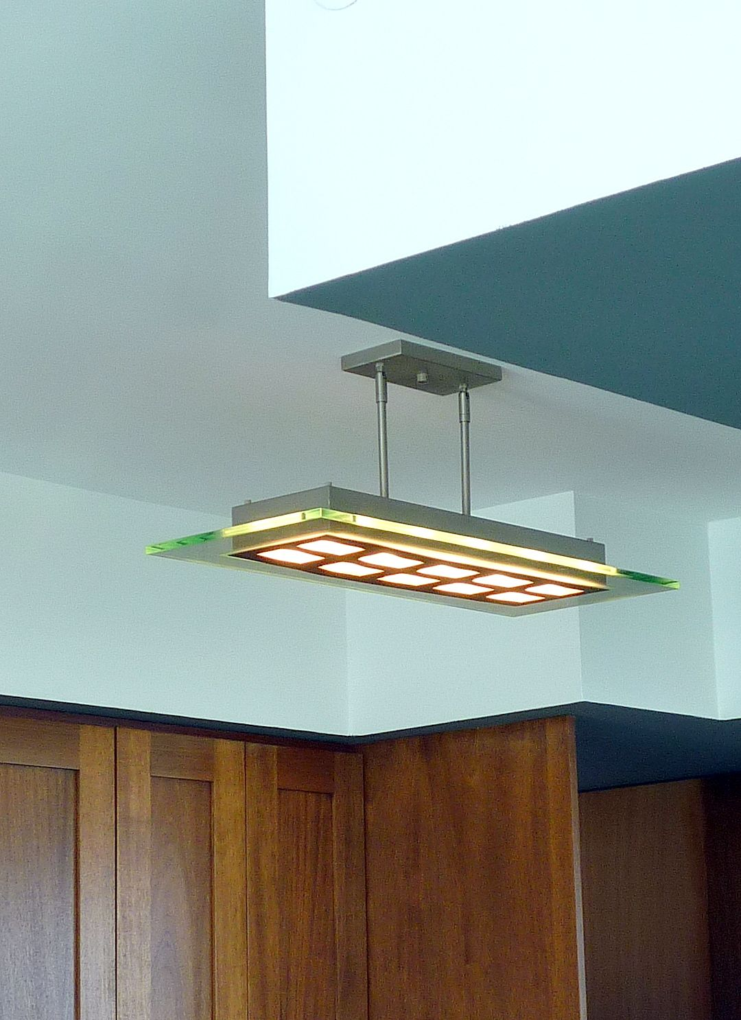 Replacing a flourescent \'cloud\' fixture, this LED light illuminates ...