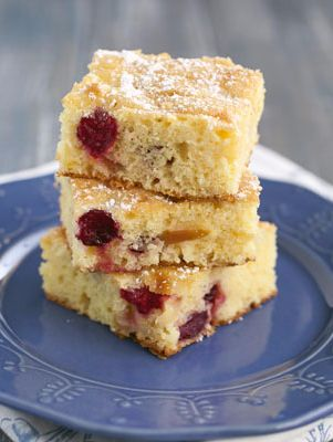 Apple Cranberry Cake - A hint of orange zest combined with chunks of fresh apple and juicy cranberries make this unique fruit-filled coffee cake recipe a winner for breakfast or brunch. Just sprinkle with powdered sugar and serve warm - it would also make a yummy dessert.