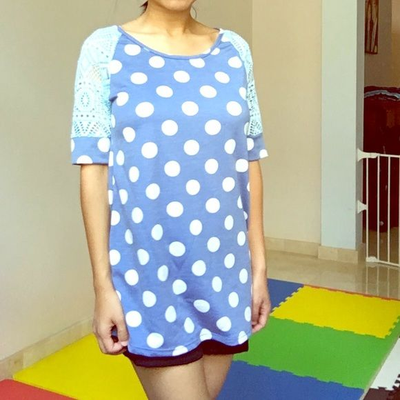 Blue polka dot top Blue polka dot print top with geometric lace cutout sleeves. 60% polyester 35% rayon 5% spandex. Made in USA 12PM Tops Tees - Short Sleeve