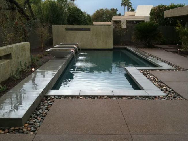 concrete pool deck with dark concrete | Swimming pool ...