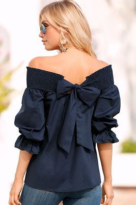 aae1ab88749b Get your sexy back in our woven off-the-shoulder blouse detailed with a  dramatic smocked neckline