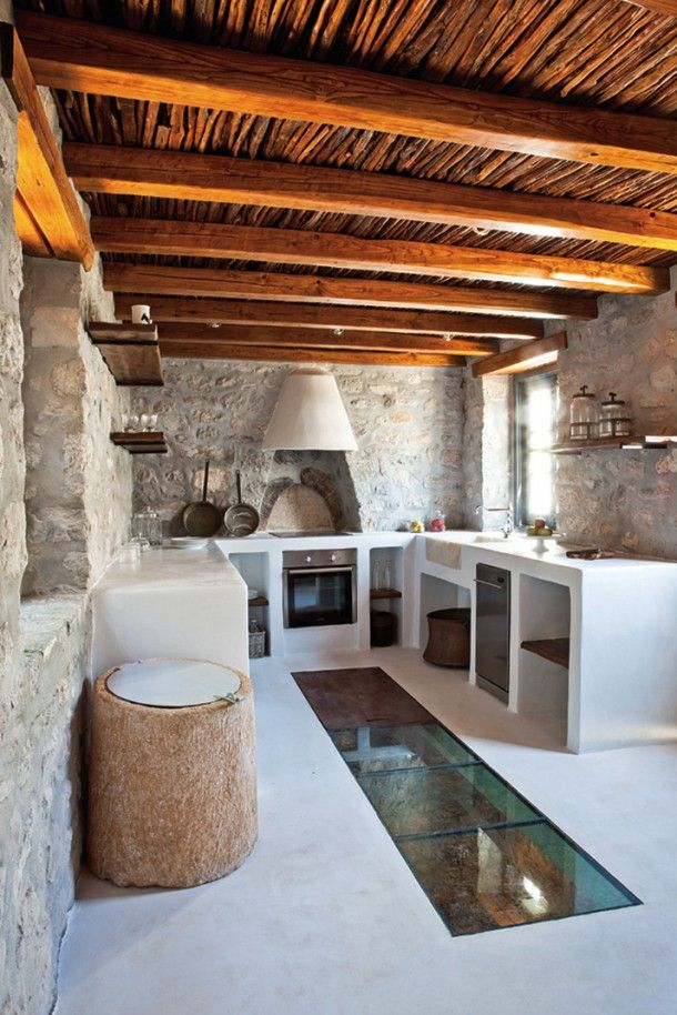 This kitchen is so beautiful charming rustic all the stone with the wood beam ceiling a private residence by interior designer tina komninou in hydra