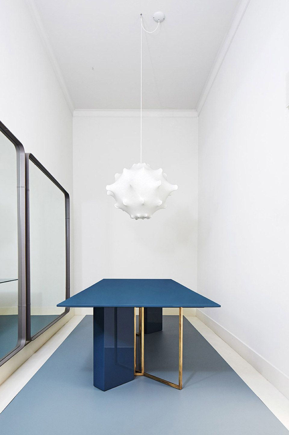 The ultra customizable rectangular dining table by Meridiani Editions in navy blue and gold.