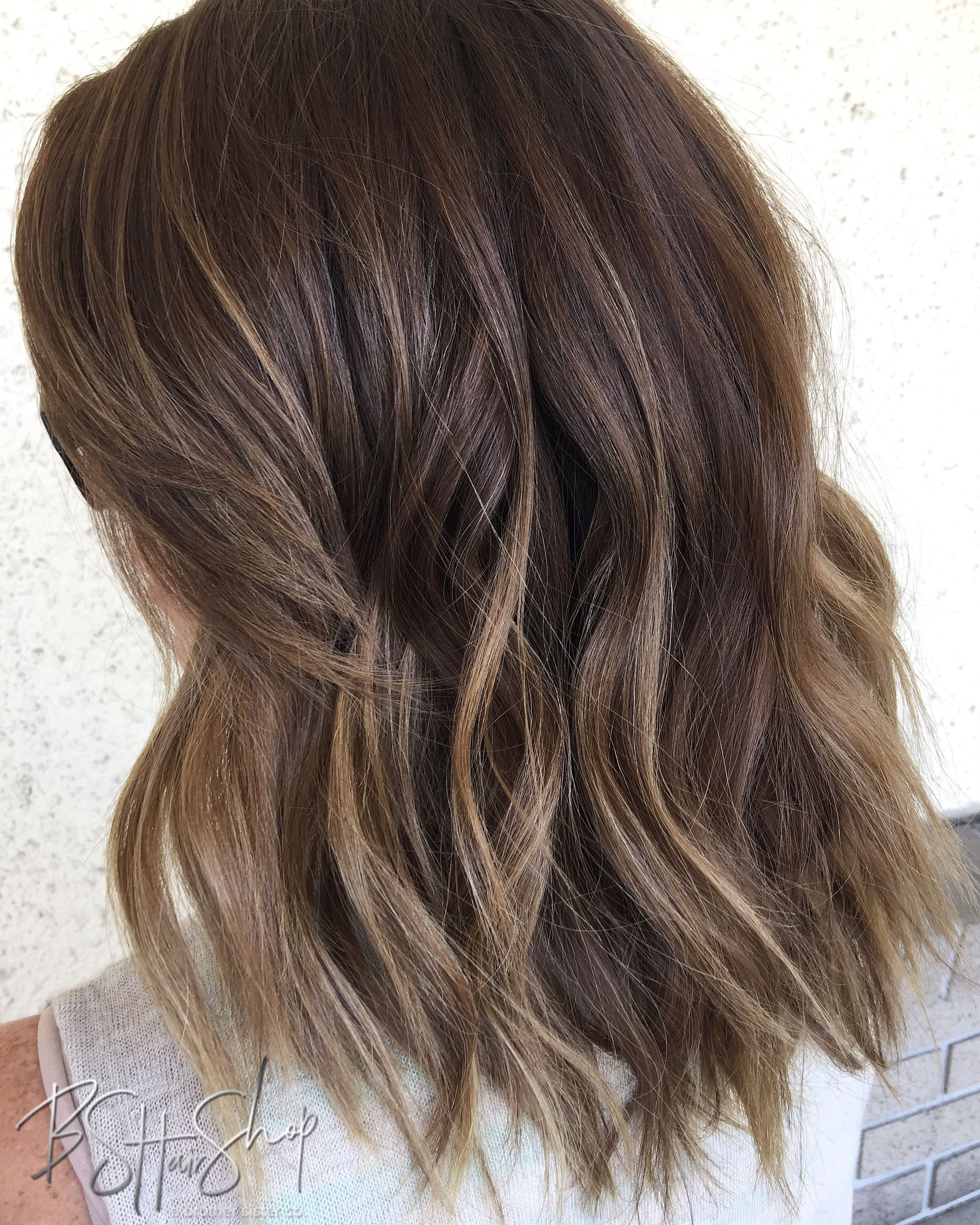 Brunette And Caramel Blonde Subtle Balayage And Textured Beachy Lob Mid Length Hair Subtle Balayage Brunette Black Hair Balayage Hair Lengths