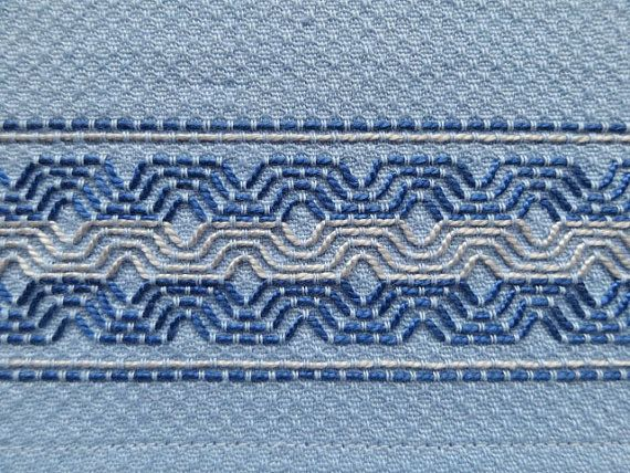 This tea towel is done on light blue huck toweling using a darker blue and steel blue thread. It is created using the needle art of Swedish Weaving. The towel measures 20-1/2 x 15-1/2, 100% cotton and entirely hand-stitched. Use it as a dish towel, hand towel for guests, or any number of uses.  Completed in my smoke-free, pet-free home. #dishtowels