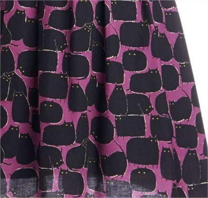 The roly, semi-creepy black cats on this dress are adorable!