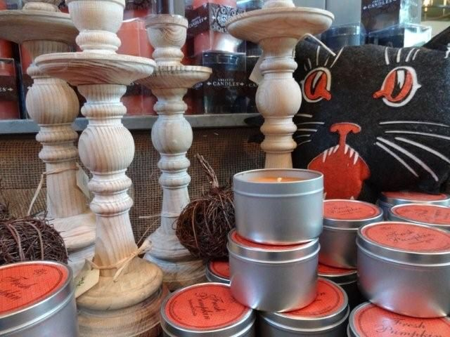 curvy wooden candlestick holders, fresh pumpkin candles and kitty pillows