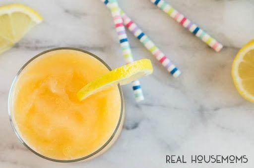 Boozy Frozen Peach Lemonade #frozenlemonade Boozy Frozen Peach Lemonade With Frozen Peach Slices, Sugar, Frozen Lemonade Concentrate, Vodka, Lemon Slices #frozenlemonade