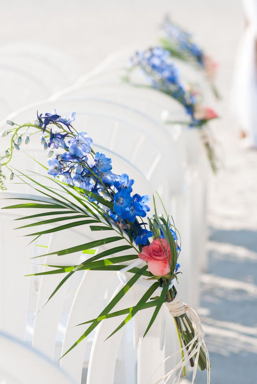 Wedding Ceremony Decor With Palm Tree Leaves Pink Roses And Blue Flowers On White Beach