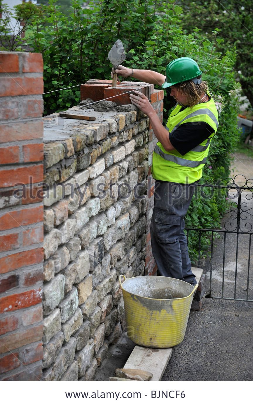 Stock Photo Building Of A Garden Wall With Cotswold Stone And Reclaimed Red Bricks Uk Garden Wall Reclaimed Brick Garden Patio Stones