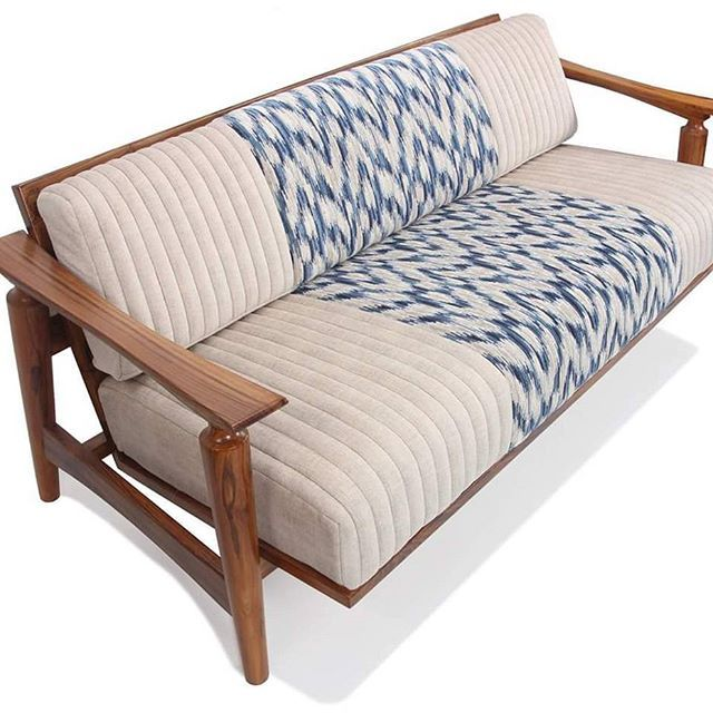 A Three Seated Low Height Sofa With Entire Wooden Frame