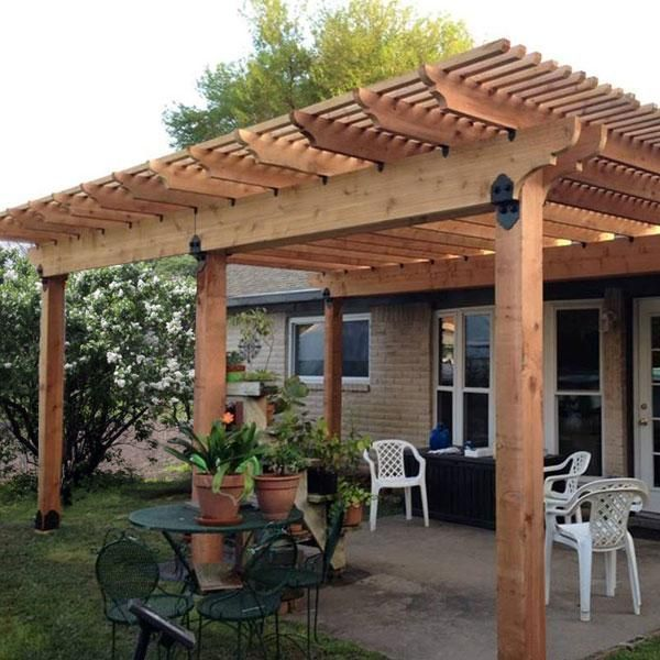 This image features a pergola constructed using the Post Base Kit, Post to  Beam Bracket Kit, and Rafter Clips from OZCO Ornamental Wood Ties - This Image Features A Pergola Constructed Using The Post Base Kit