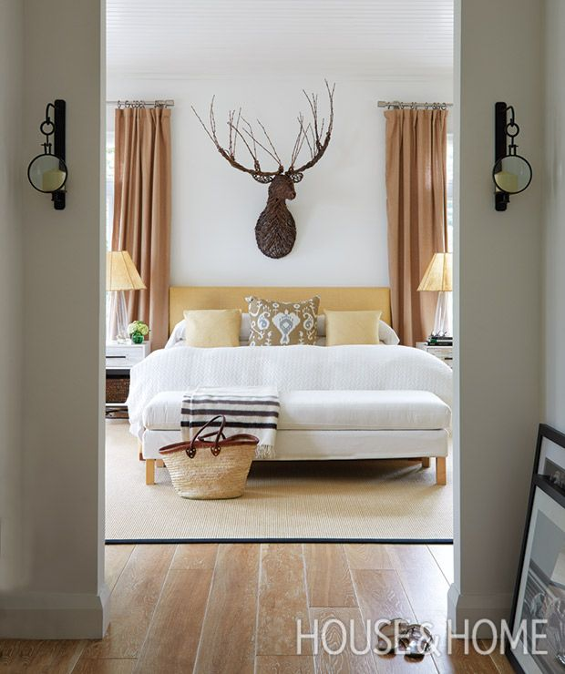 A stag bust made of branches acts as sculpture in the principal bedroom. | Photographer: Virginia Macdonald Designer: Montana Burnett