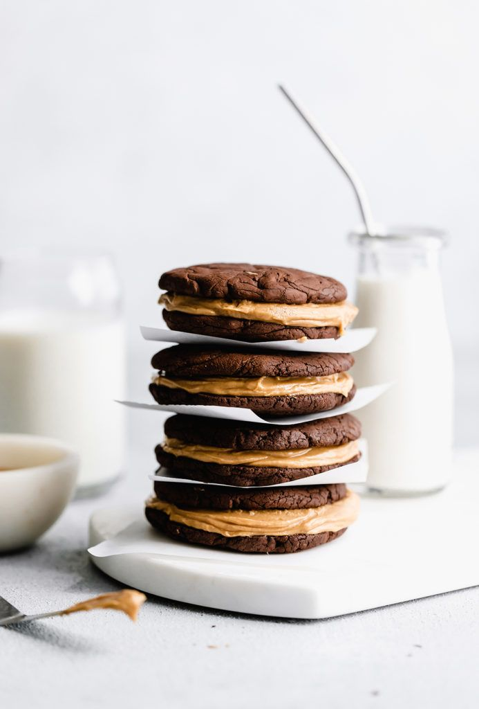 peanut butter brownie sandwich cookie soft and fudgy brownie cookies with melted chocolate bits sandwiched between a creamy peanut butter frosting. These PB Brownie Sandwich Cookies are the treats you never knew you needed!