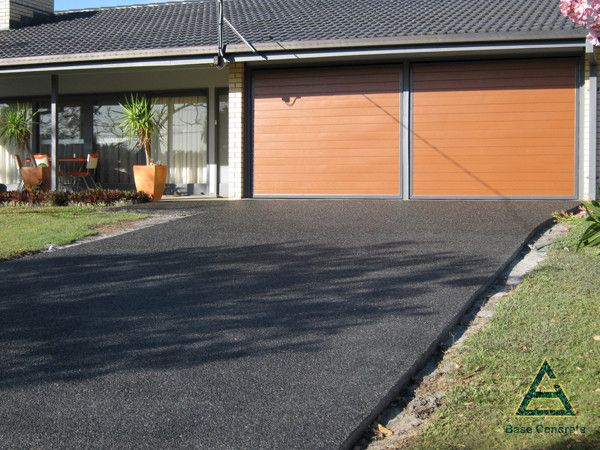 Black exposed aggregate with black coloured concrete for Base for concrete driveway