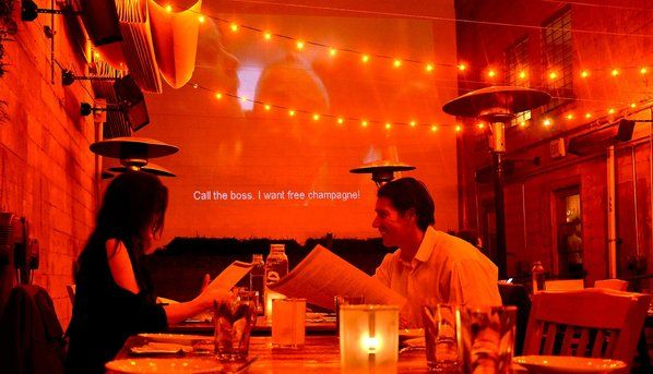 Great food, cool movies. The kitchen turns out elegant California-Mediterranean cuisine and a tall, whitewashed patio wall serves as movie s...