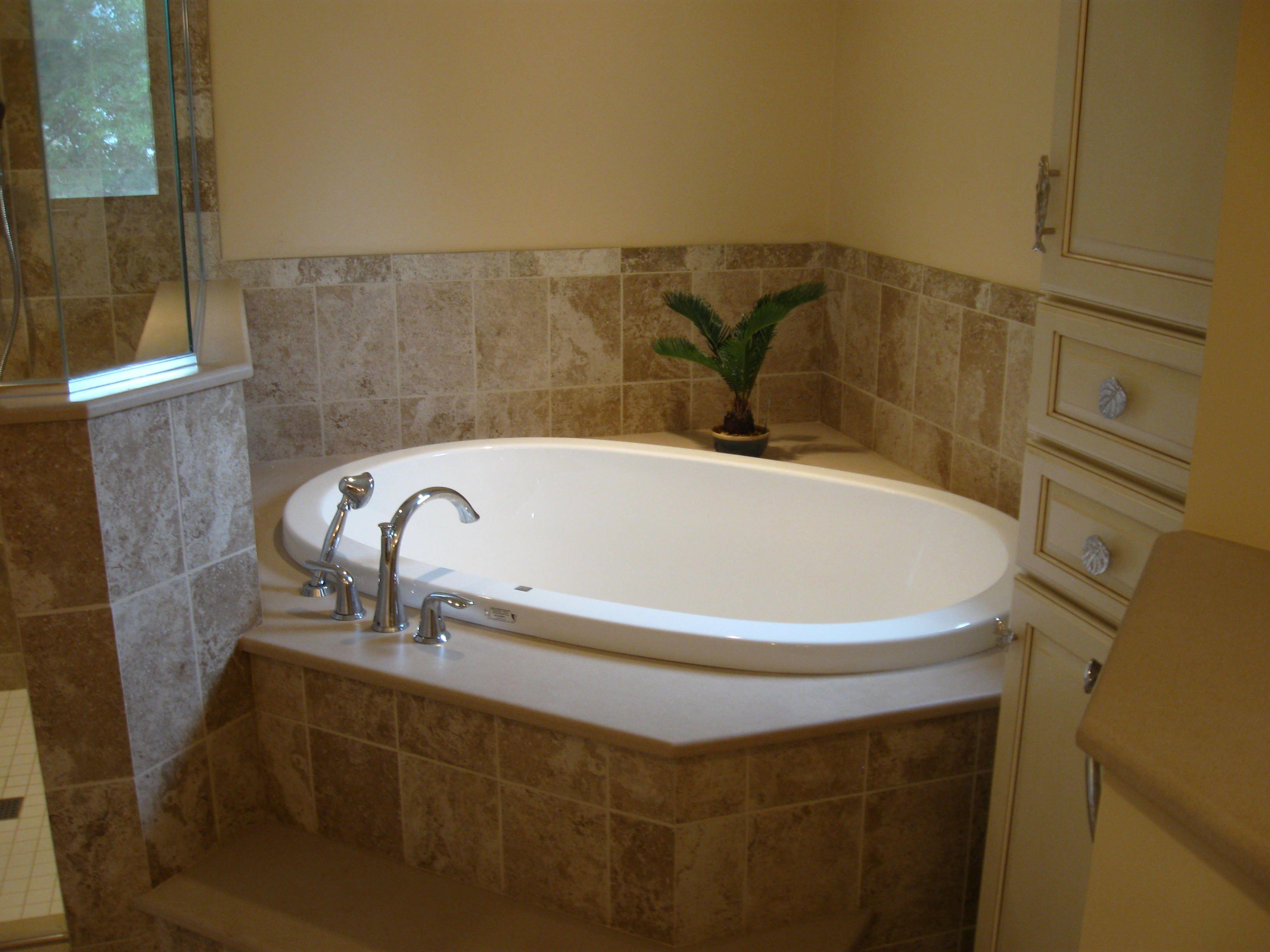 Kohler soaker tub, Kohler faucet solid surface step and deck, and ...