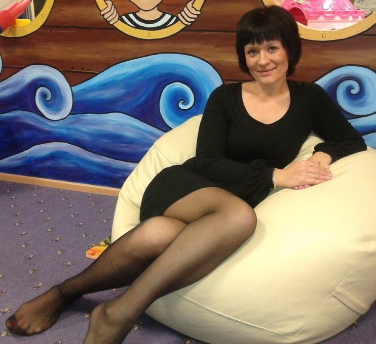 Sexy mature legs in black pantyhose