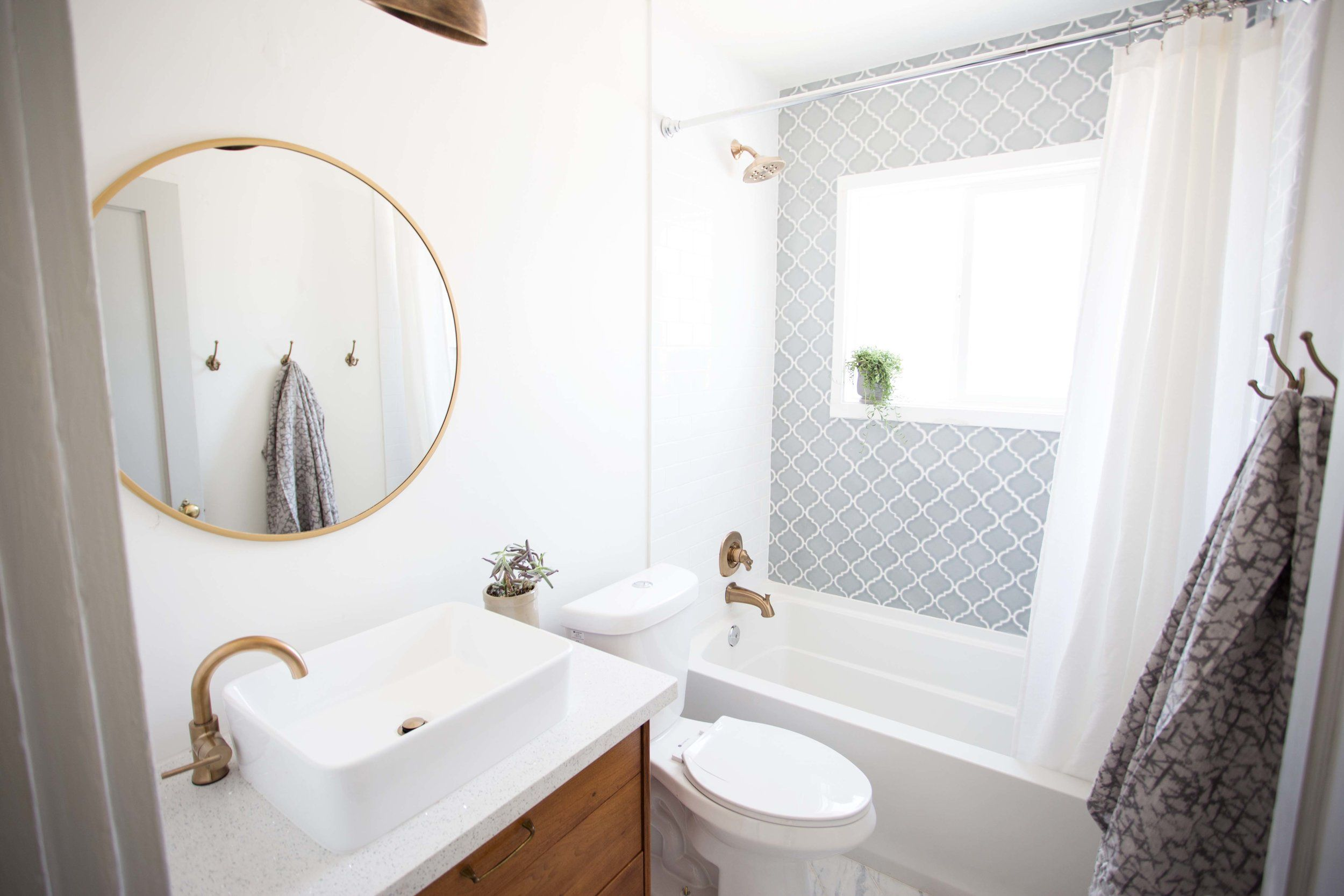 Use subway tile to fade away when using a busier accent tile ...