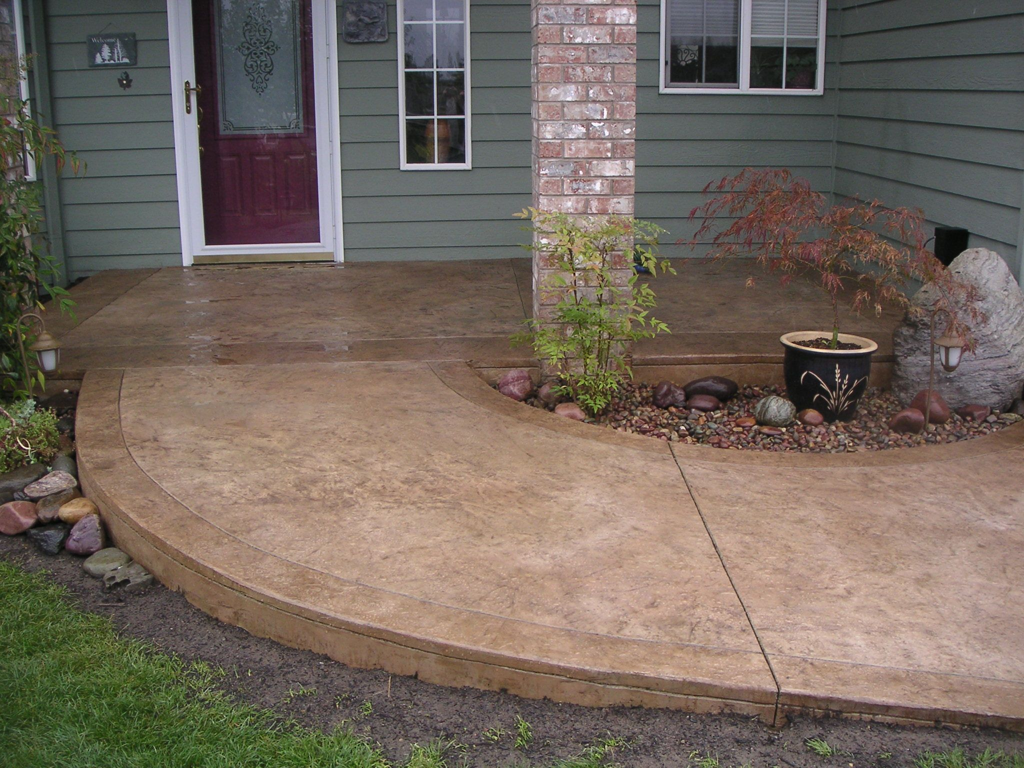Stained cement porch concrete walkway ideas cement for Home walkway ideas