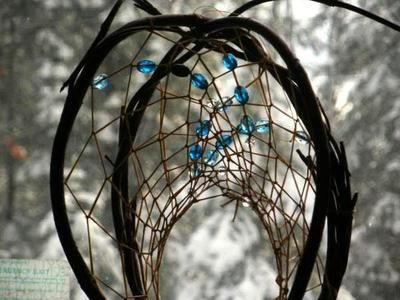 double hooped dreamcatcher with blue glass beads. by Tales of Laughing Fox