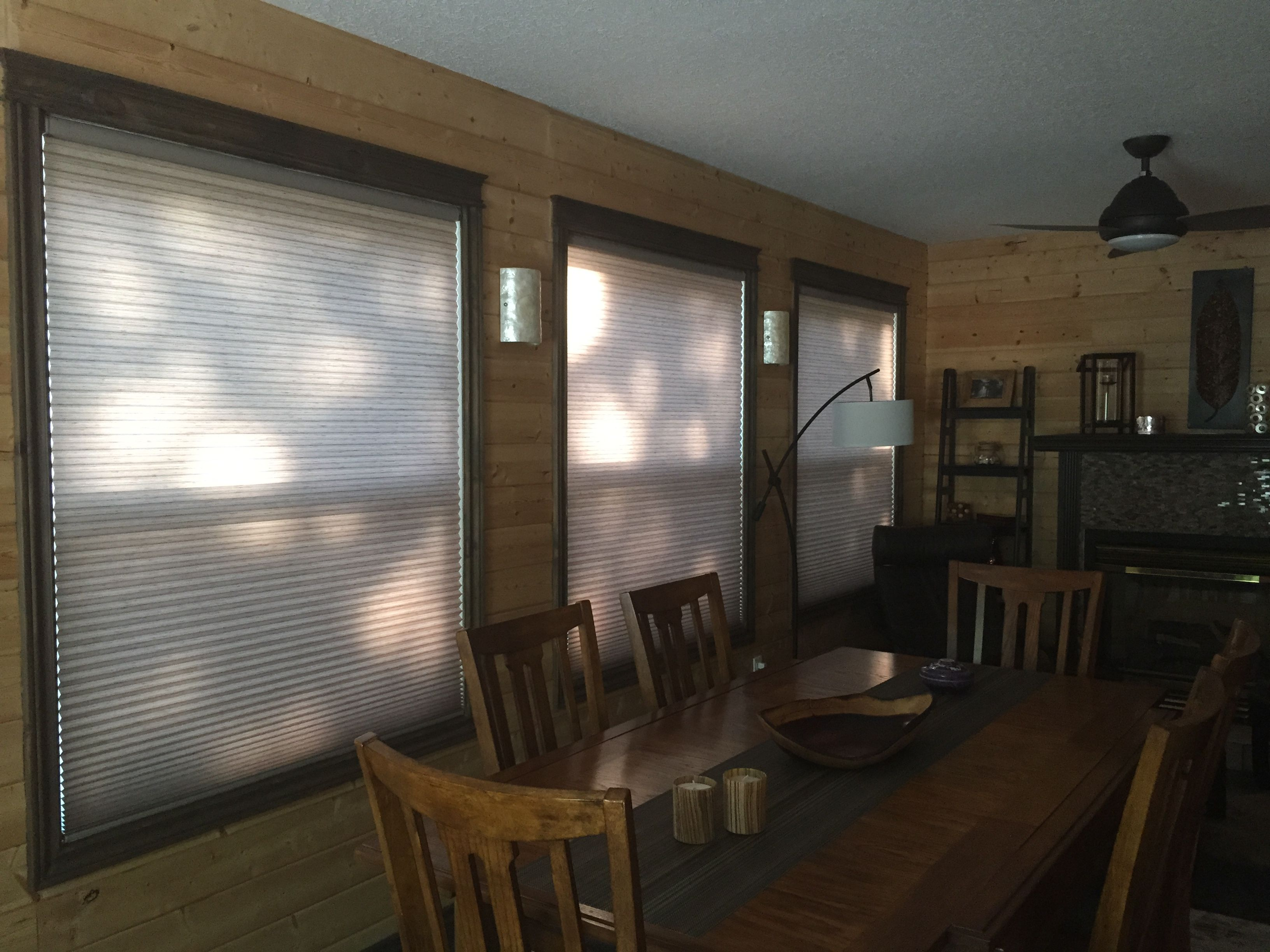 House window shade design  cabin with closed motorized hunter douglas honeycomb window shades