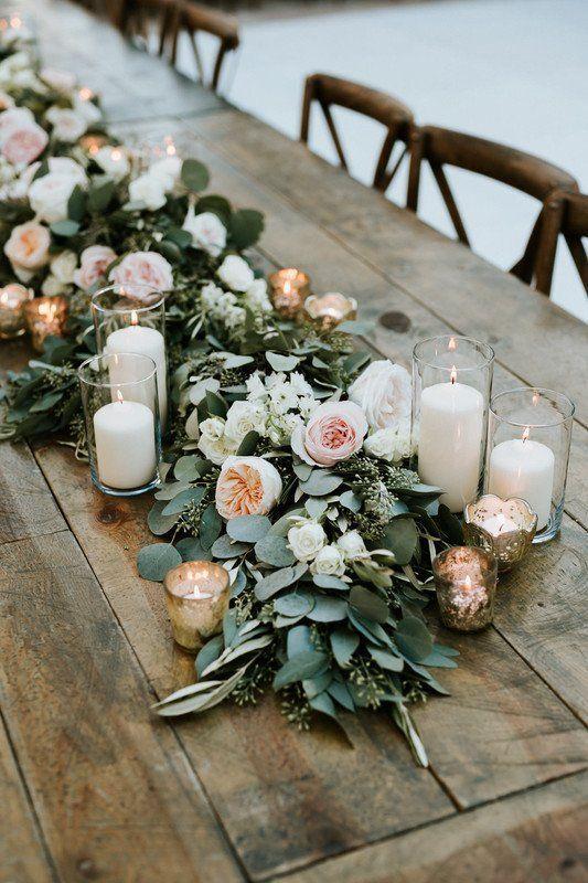 Greenery garland wedding centerpiece with peonies + candles #weddings #garlandofflowers