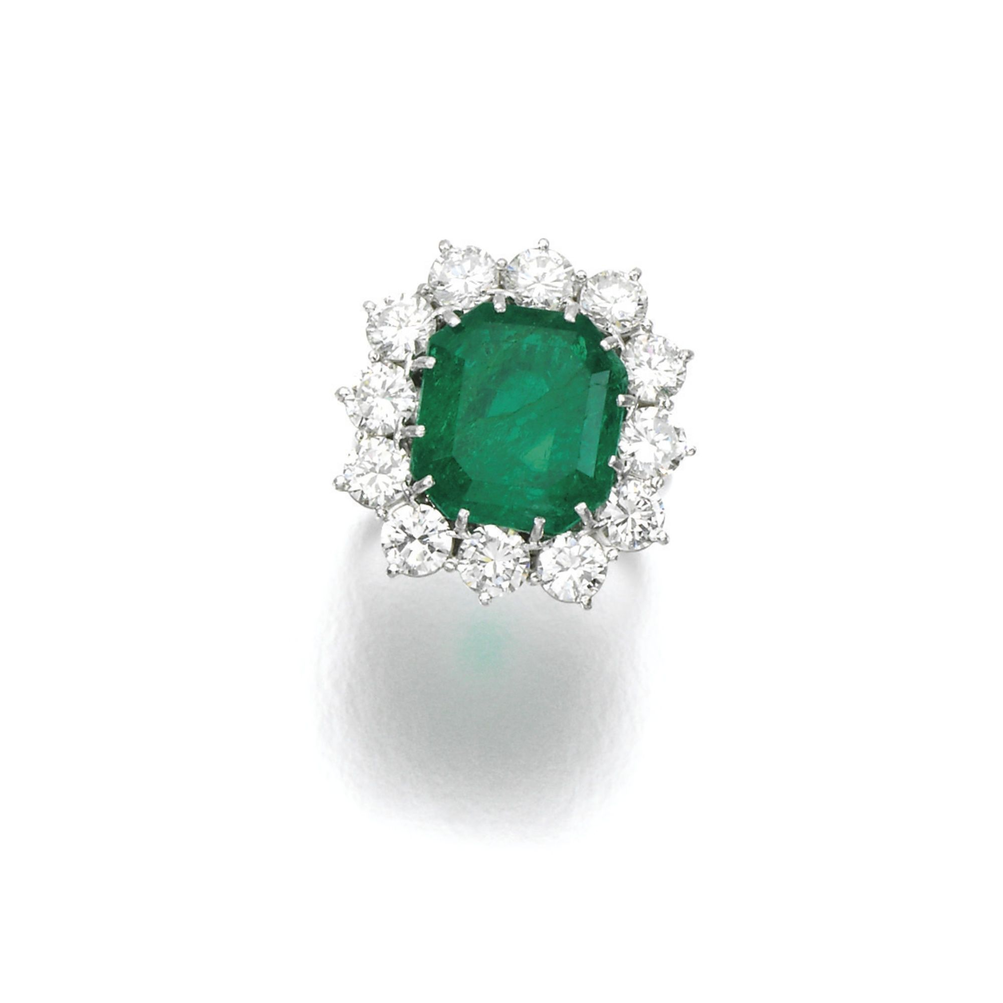 circular brooch a brilliant with emerald set pin diamond cut and