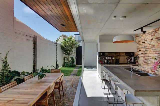 Superb Large Glass Doors Can Be Slid Open To Connect The Kitchen With The Courtyard,  Creating
