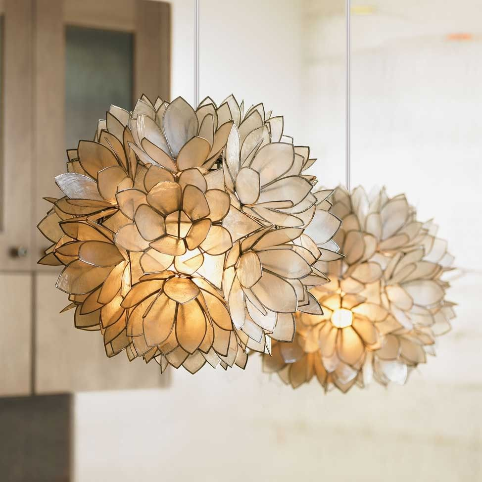 Lotus flower chandelier artisans assemble hand cut capiz shells lotus flower chandelier artisans assemble hand cut capiz shells edged in metal to create these blooming flower chandeliers that radiate like shimmering aloadofball Images
