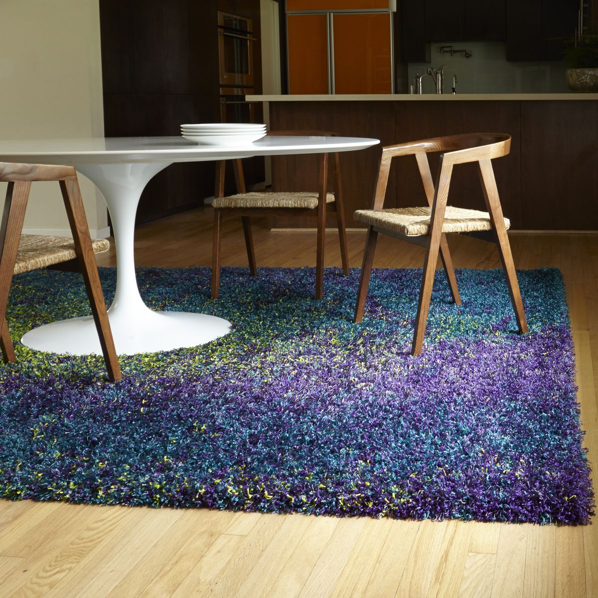 Green purple area rug - This Peacock Colored Shag Area Rug Contains Purple Blue And Lime Green A