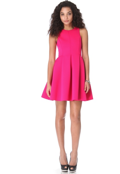 7bb052baf01 10 Eye-Catching Party Dresses Tibi Neoprene Sleeveless Dress in Shocking  Pink (525.00)  Go for an unexpected holiday color with this hot pink.